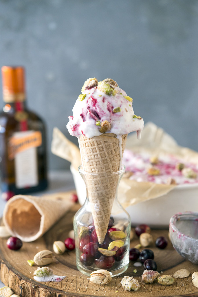 Stunning, creamy vanilla coconut ice cream with a tart cranberry Cointreau swirl, topped off with candied pistachios.