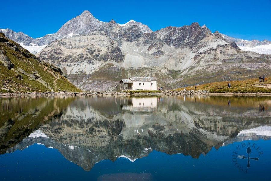 Reflections of the mountains and chapel