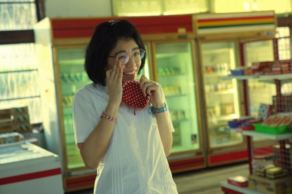 Lin Truly (Vivian Sung) trying to decide what to buy at the school provision shop.