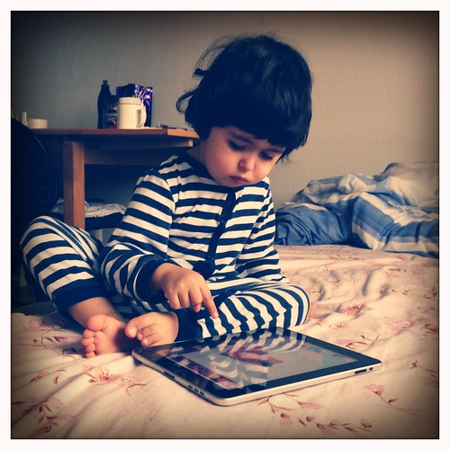 child playing with ipad. gadget kids,