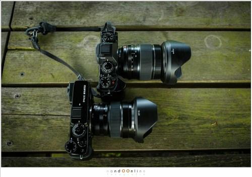 De Fujifilm X-T1 (boven) en de X-PRO2 (onder). De laatst genoemde is minder slank en robuuster