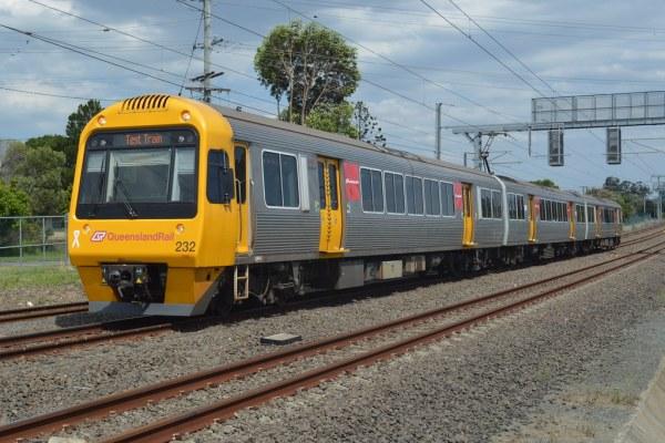 Queensland Rail SMU232 working a test train approaches