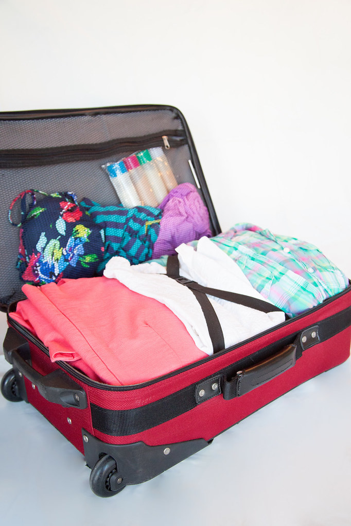 Pack Your Bags Luggage Clothes Packed In A Suitcase Or