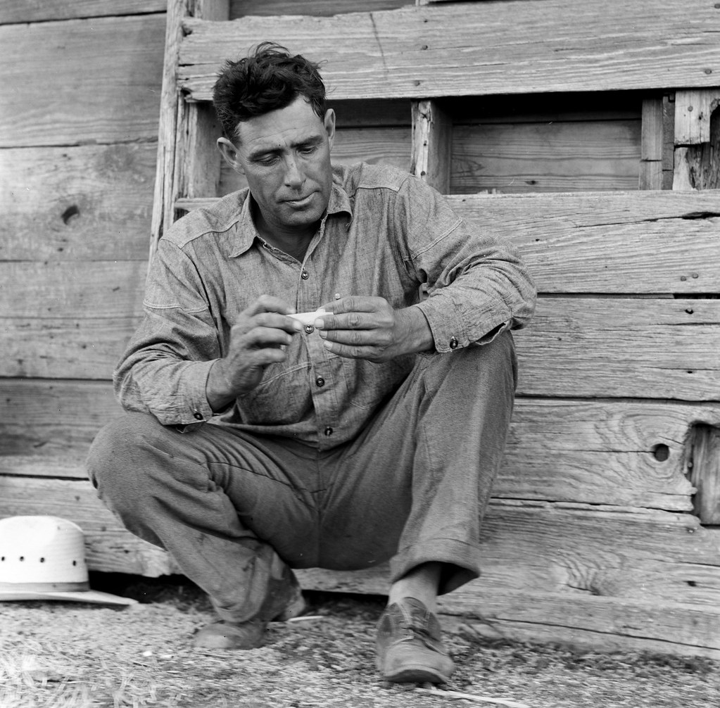 Goodliet, Hardeman County, Texas. James Abner Turpen, a Texan farmer on relief – 'Tractored out' in late 1937. Now living in town, and on the verge of relief. Wife and two children.