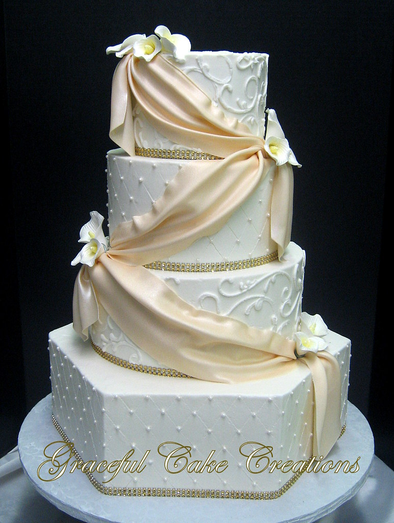 Elegant White Butter Cream Wedding Cake With A Champagne C