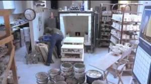 Tom Edwards emptying his kiln