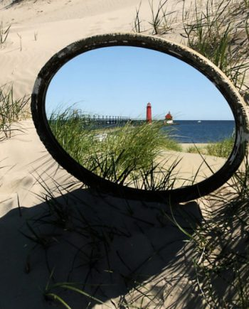 image of grand haven lighthouse reflection in antique mirror