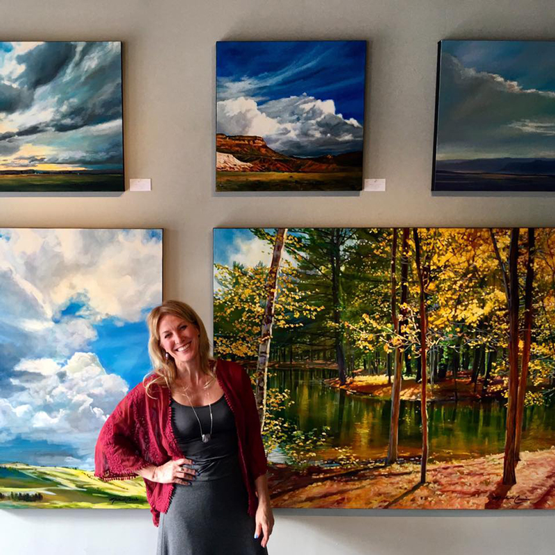 Michelle Courier with her paintings