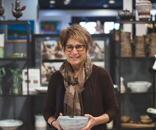 Cyndi Casemier holding a handmade ceramic bowl