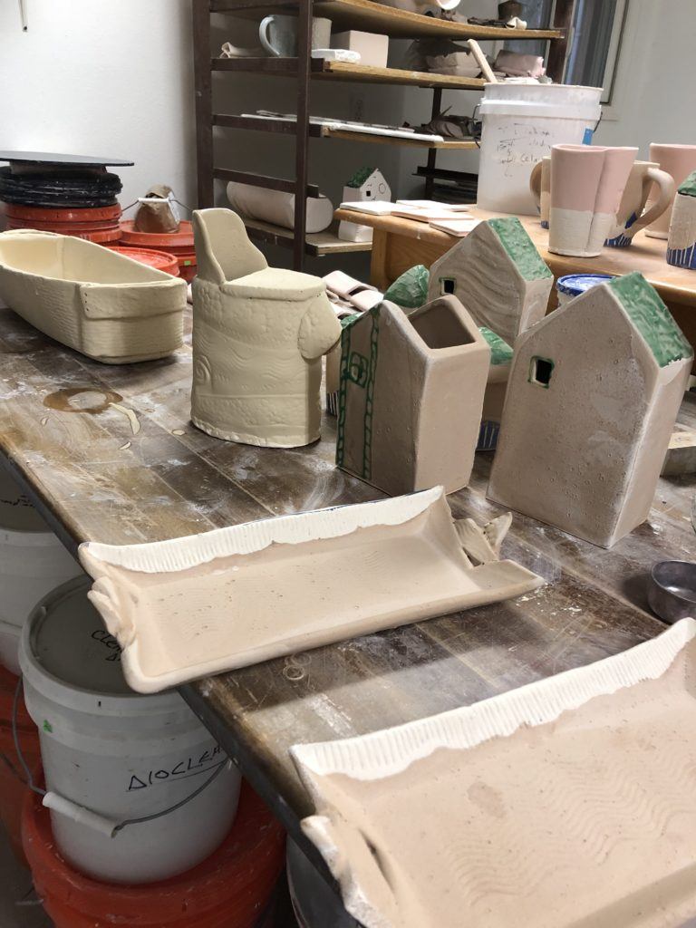 Glazed pots waiting to be fired