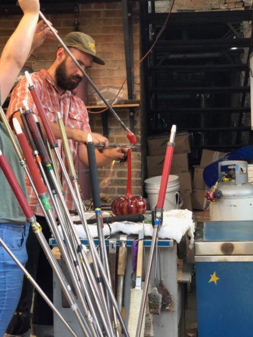 Eli Zilke making a glass pumpkin