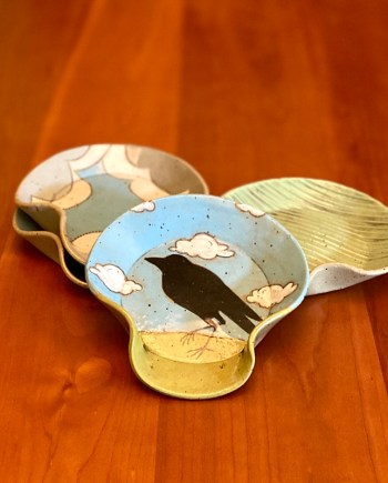 raven spoon rest with 2 others on a table