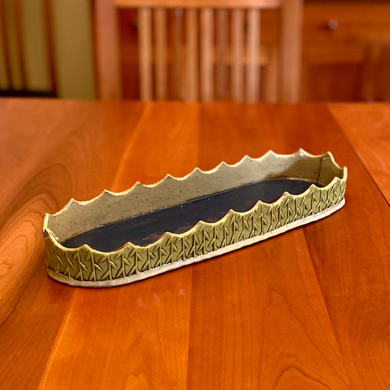 large handmade ceramic tray sitting on a table