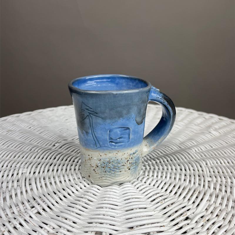handmade mug by cyndi casemier with lake michigan beach sand