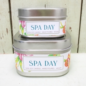 small and large tins of spa day candles by green daffodil