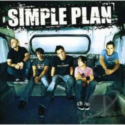 """Jeff Stinco, Sebastian Lefebvre, Pierre Bouvier, David Desrosiers, and Chuck Comeau of Simple Plan on a bus. The words """"Simple Plan""""are at the top in white letters."""