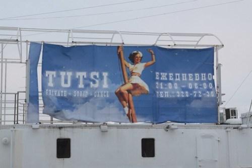 Floating on the River Neva, a strip club called 'Tutsi'