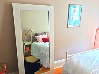 Guest Room Large DIY Mirror Reflecting Upon White Iron Bed