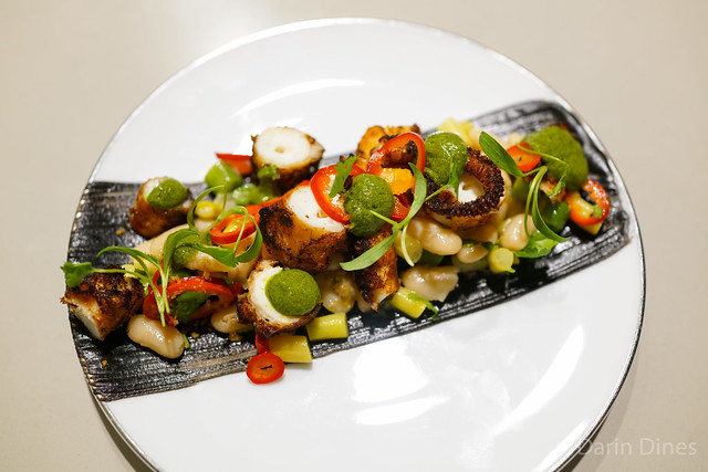 Spanish octopus grilled, wax and cannellini bean salad, vietnamese herbs
