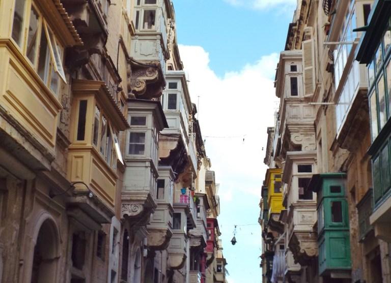 Balconies on a street in Valletta, Malta - the tea break project solo female travel blog