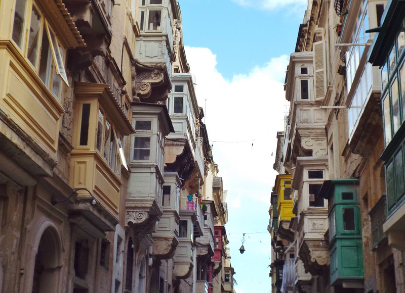 Balconies on a street in Valletta, Malta - the tea break project solo female travel blog