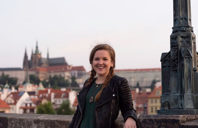 Angela Portrait on Charles Bridge with Old Prague Castle in the Distance