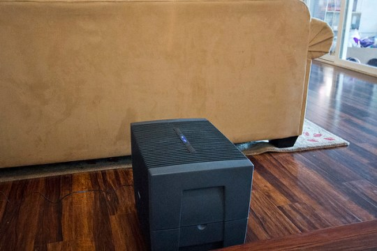 venta airwasher behind the couch.