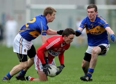 Cork's Mark Collins is challenged by Tipperary's Brian Fox and Seamus Kennedy.