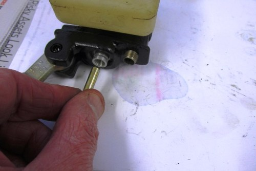 Pin Inserted In Hole in Rear of Master Cylinder Piston Assembly