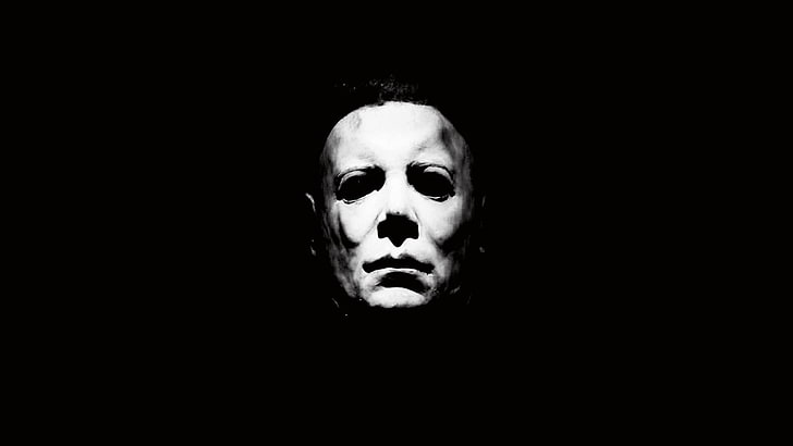 Scary priest holding a cross while staying in the dark place. Hd Wallpaper 1978 Black Dark Halloween Horror Michael Myers White Wallpaper Flare