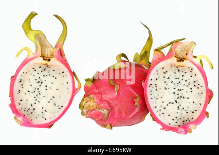 Pitahaya or Dragonfruit (Hylocereus undatus), whole and halved fruit - Stock Photo
