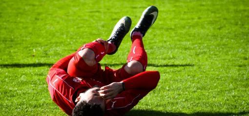 Soccer player suffering a sprain or strain.