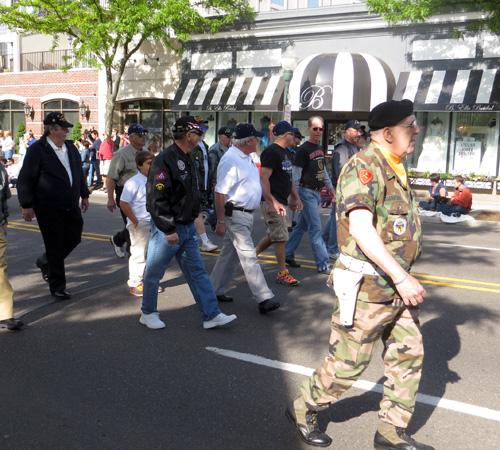 veterans walk down Main Street