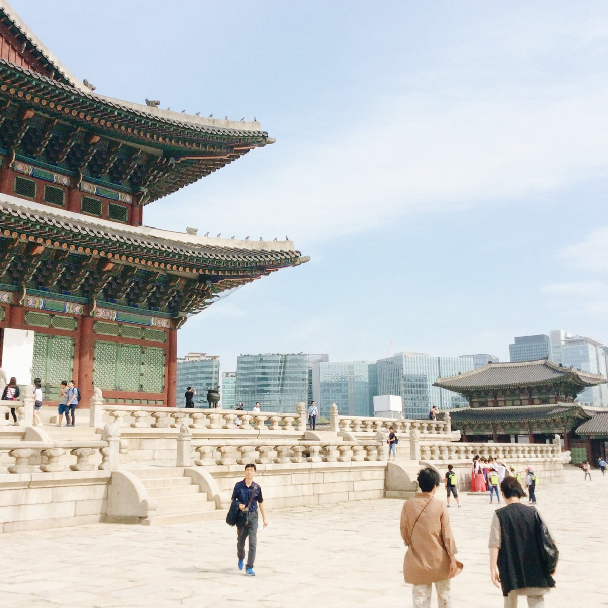 The throne hall of Gyeongbokgung Palace with the modern buildings in the background