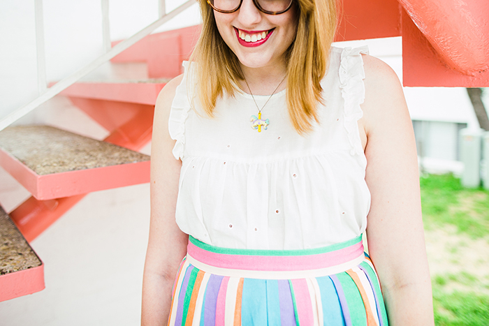 carousel necklace and colorful skirt