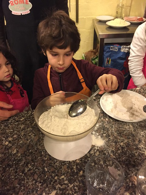 During the pizza making class in Rome each kid was given a task