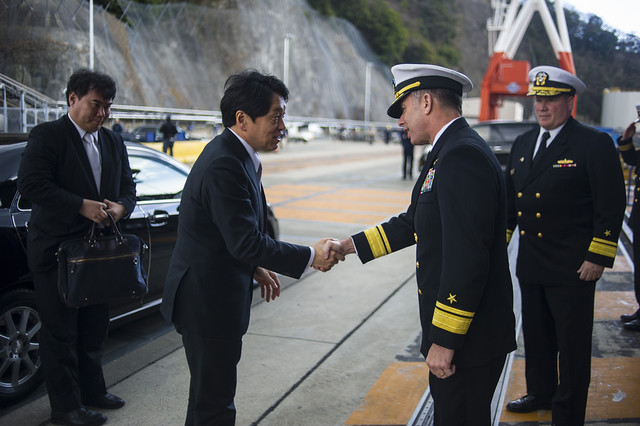 Japan Minister of Defense meets and shakes hands with commander, Naval Forces Japan