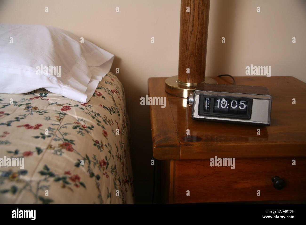 Alarm Clock In Bedroom Stock Photo, Royalty Free Image