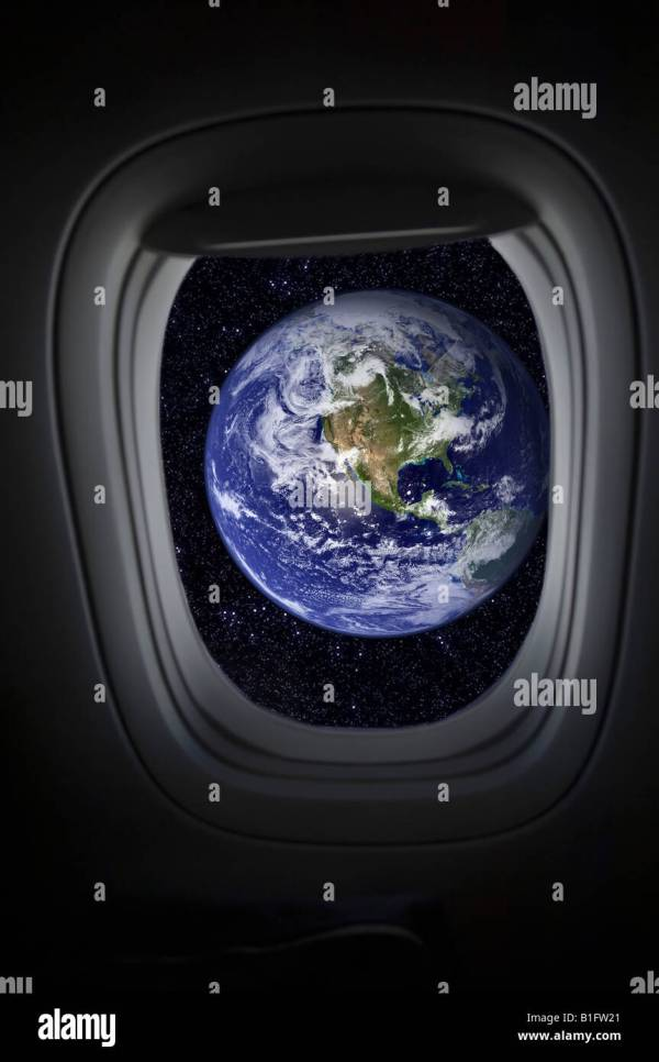 View of earth from spacecraft window Stock Photo Royalty