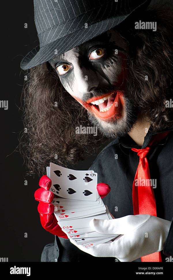 Joker with cards in studio shoot Stock Photo, Royalty Free ...