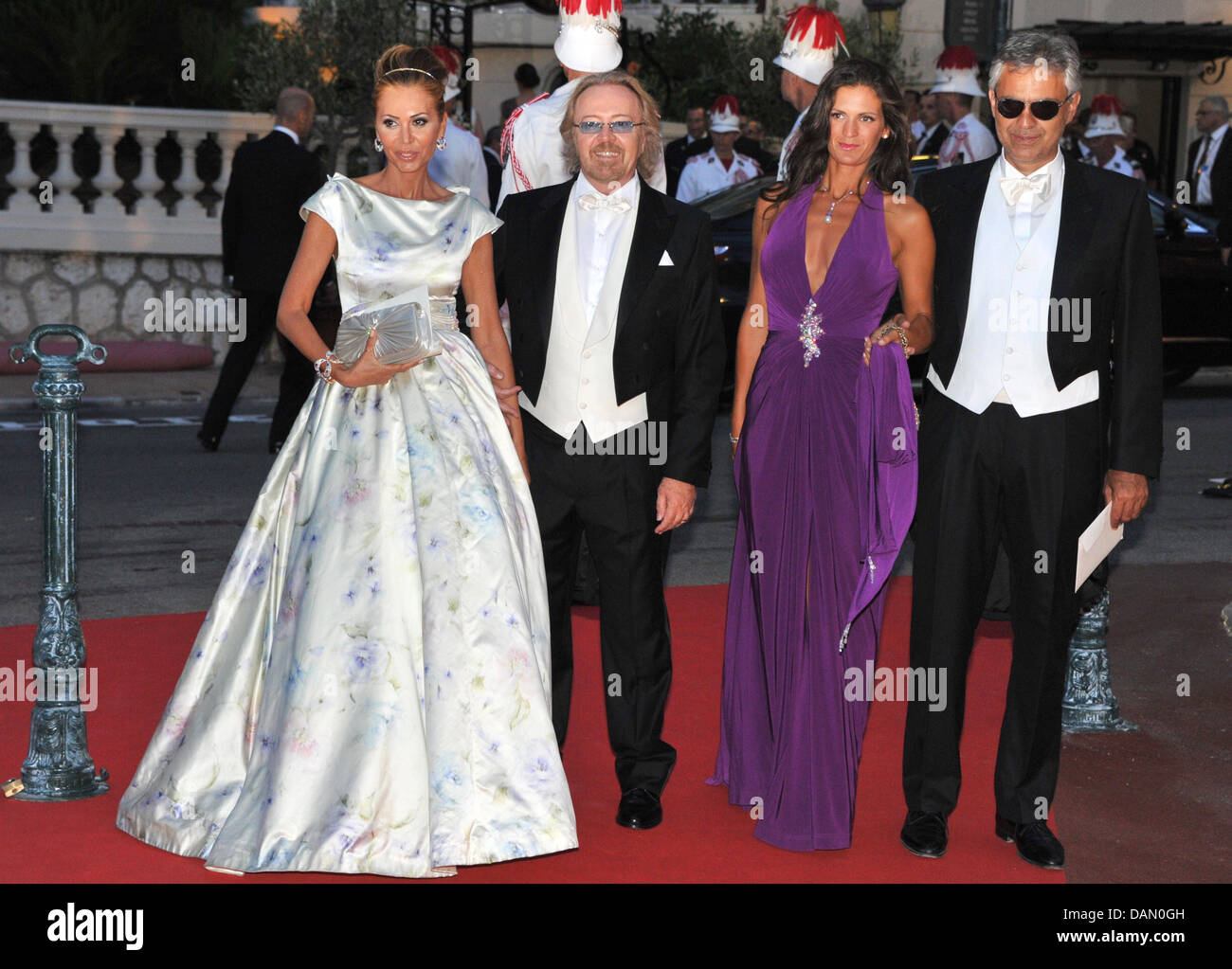 Umberto Tozzi (2ndL) and singer Andrea Bocelli (R) and their partners attend the official dinner on the Opera terraces Stock Photo