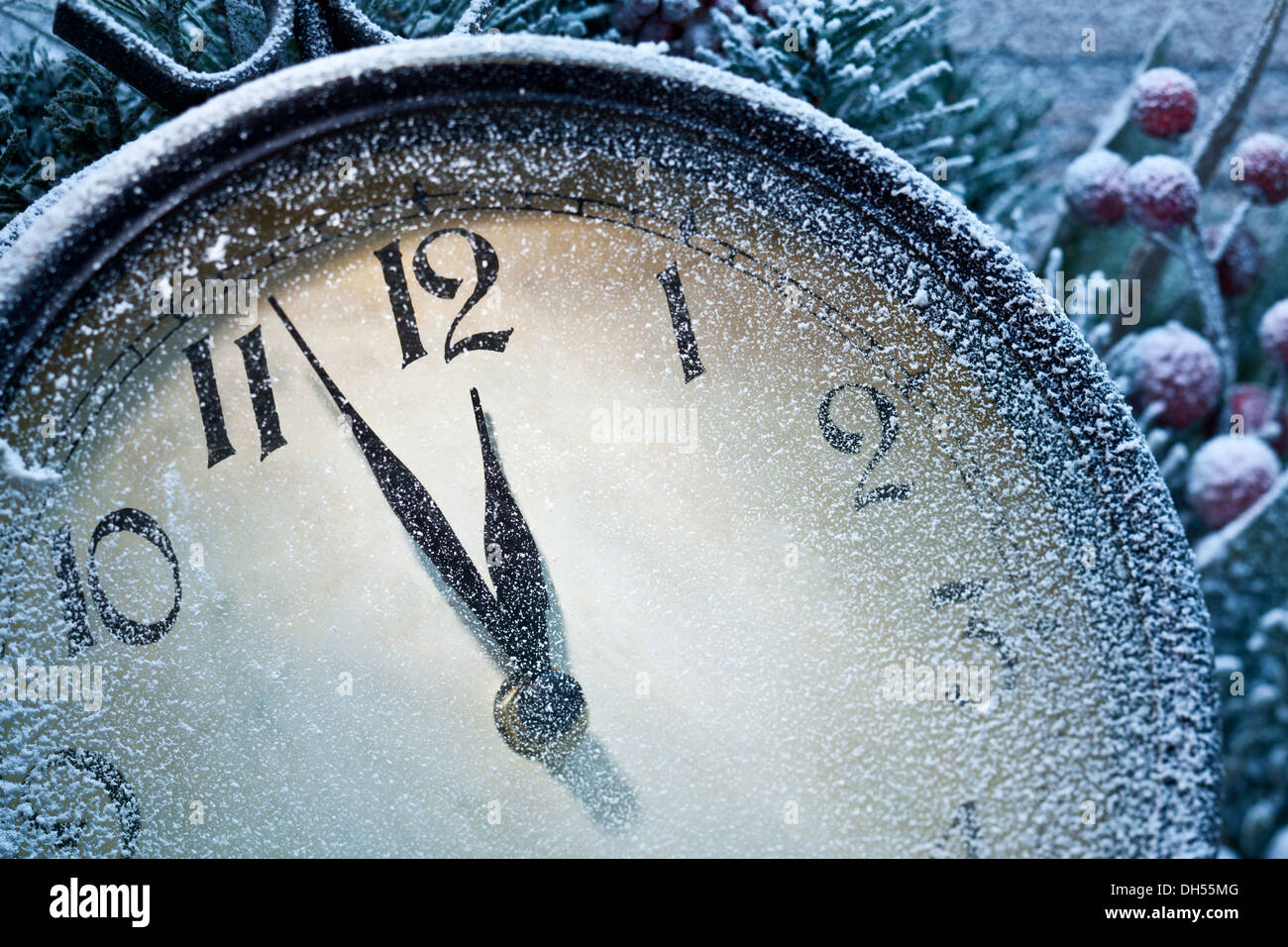 New Year clock powdered with snow  Five to twelve Stock Photo     New Year clock powdered with snow  Five to twelve