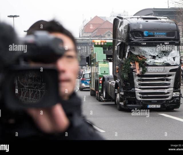Berlin Germany Th Dec  The Truck Is Towed Away Under Police Escort From The Christmas Market At Breitscheidplatz In Berlin Germany