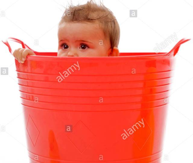Little Child Hiding In Red Tub