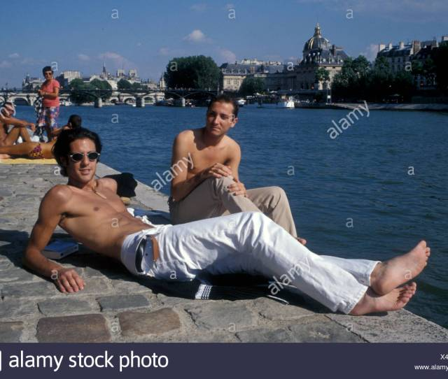 Gay Men Sunbathing On Tata Beach Next To River Seine Paris France 1997