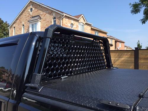 A Heavy Duty Tonneau Cover And Custom Headache Rack On A F