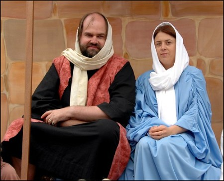 Adults in Mary and Joseph Christmas costumes