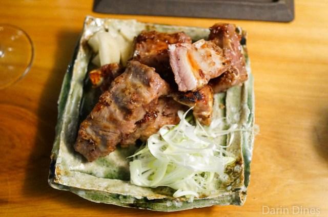 grilled heritage pork in koji rice, pickled daikon, leek