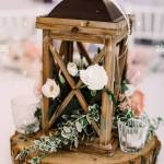 Wedding Decor Made Of Natural Materials In Rustic Style Wooden Lantern Filled With Moss Stands Stock Photo Alamy