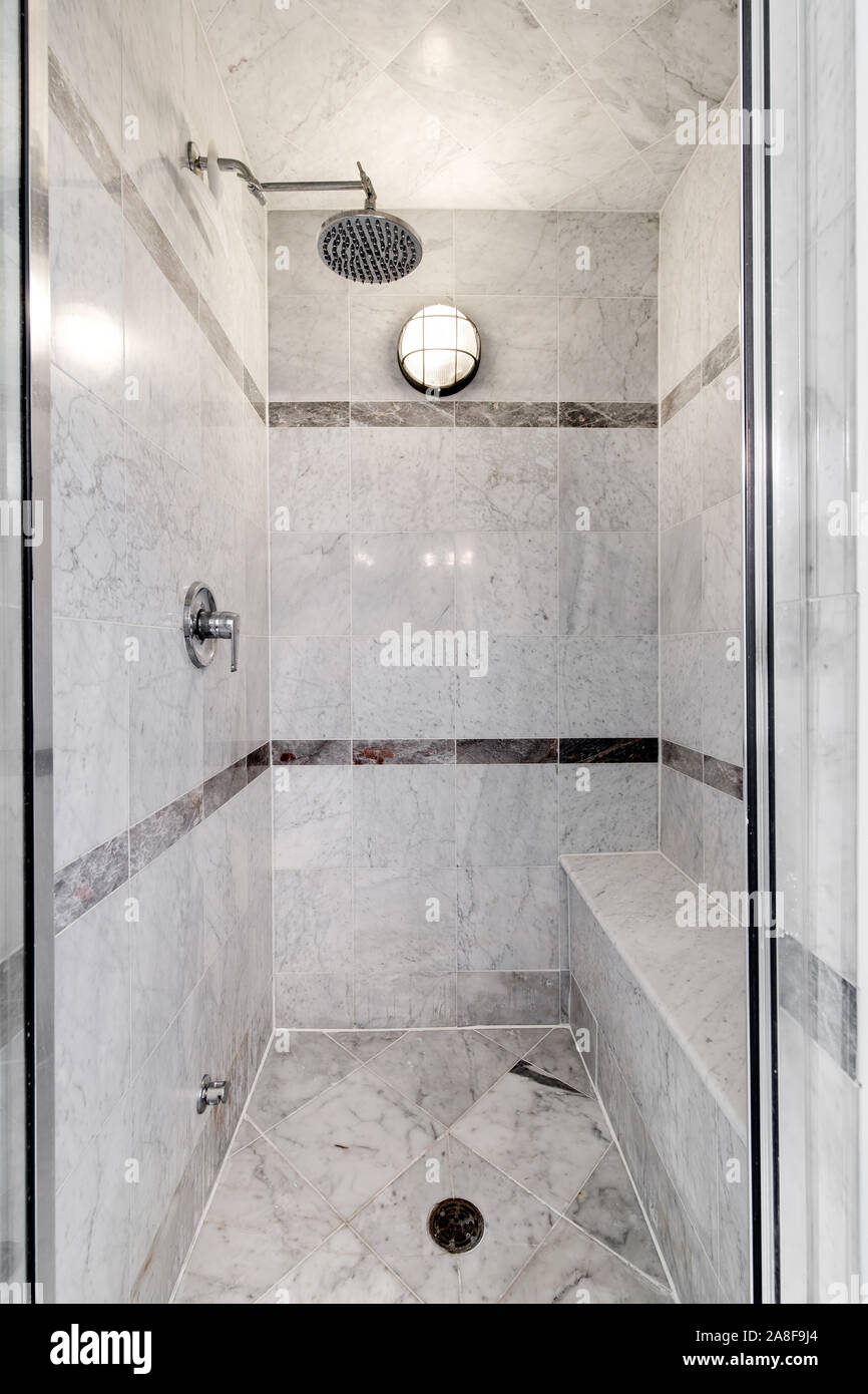 https www alamy com a luxury stand up grey marble shower with a rain shower head with accent tiles around the edge and a seat image332251084 html